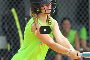 Summer Softball Camp - Girls Softball Swinging Bat
